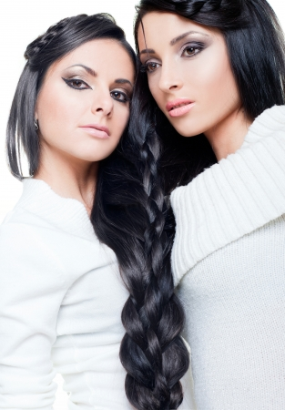 Beautiful brunettes with long braided hair photo