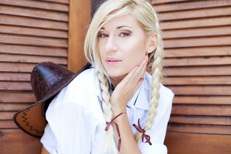 Portrait of a blond cowgirl photo