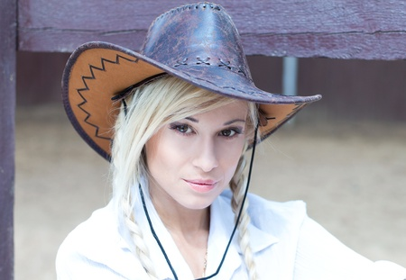 Closeup portrait of a gorgeous cowgirl photo