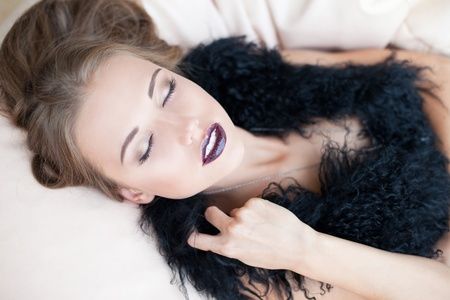 Horizontal portrait of a fashionableblond with closed eyes  Stock Photo - 11133309