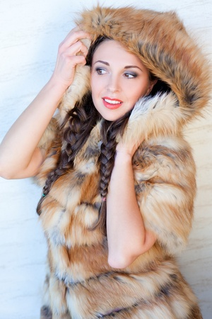 Glamorous brunette wearing fox fur photo