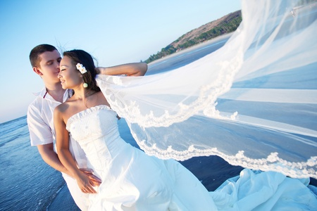 asian bride: Honeymoon couple on the beach