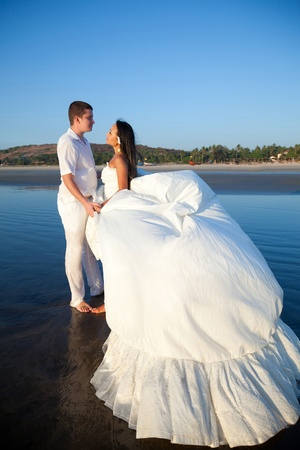 Married couple on the seashore photo
