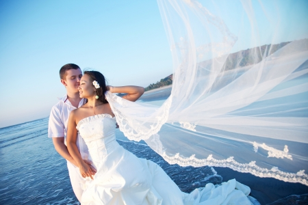 veil: Honeymoon couple on the beach