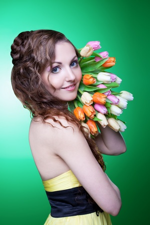 teen girl smile face: Beauty with a spring bouquet Stock Photo