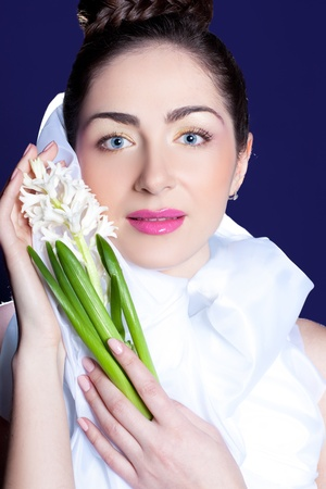 Glowing brunette with white hyacinth Stock Photo - 13155639