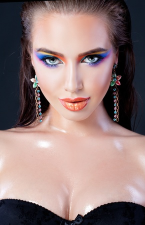 Hot young model with plump lips and colorful makeup photo