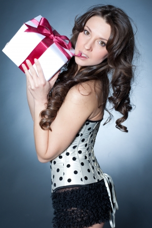 Beautiful woman Unwrapping the gift photo