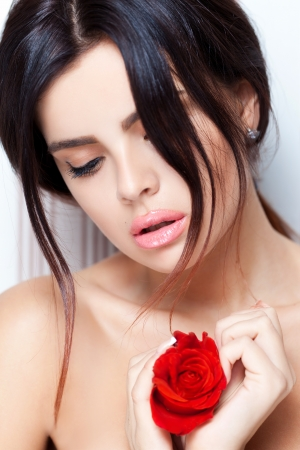 Rose with sensual temptation woman photo
