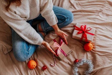 person holding christmas gifts