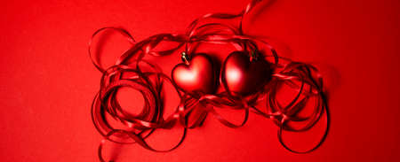 red hearts with red ribbon. valentines day background . High quality photo