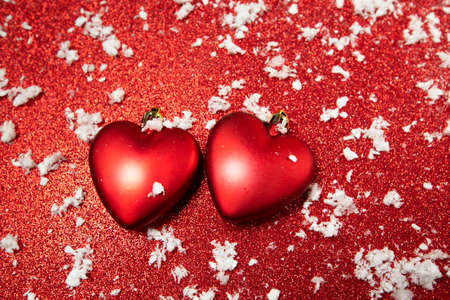 red hearts on a red background with snow. High quality photo