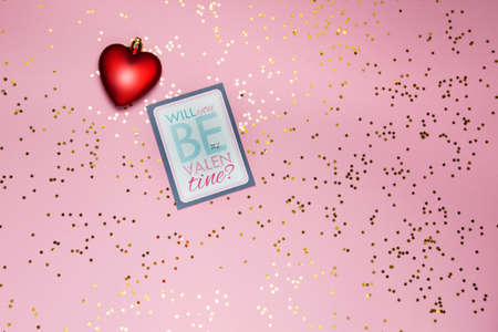 red small heart and valentines day card on pink background. High quality photo