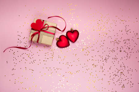 Gift box to Valentines Day on a pink background with glitter. High quality photo
