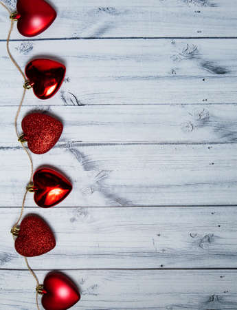 red hearts on a light wooden background. valentines day. High quality photo