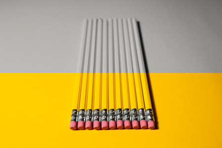several pencils on a two-color background yellow and gray. High quality photo 版權商用圖片