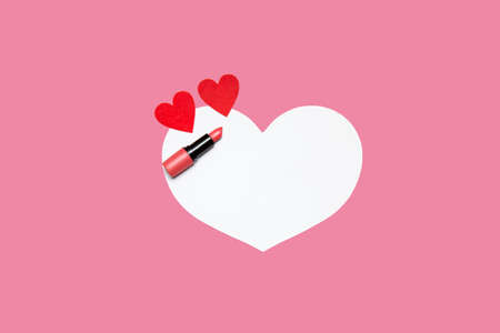 lipstick and small hearts on a pink-white background. High quality photo
