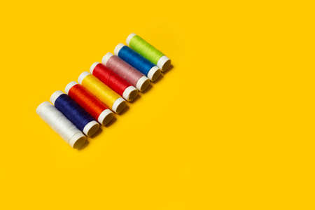 skeins of multi-colored thread on a yellow background. High quality photo