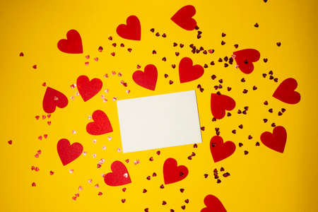 yellow background with red hearts and place for text. High quality photo