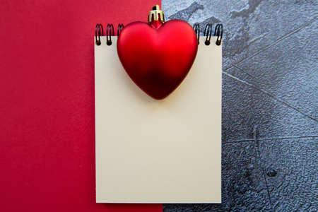 notepad and red hearts on a red-gray background. High quality photo 版權商用圖片
