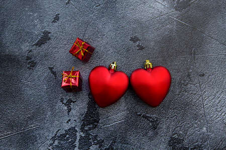 red hearts on dark background for valentines day. High quality photo
