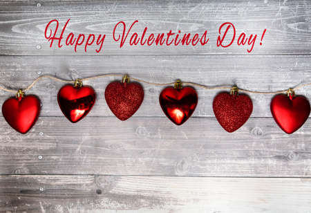 happy valentines day background, red hearts on a wooden background. . High quality photo 版權商用圖片