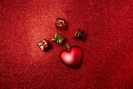 heart and small red gift boxes on a red background. valentines day concept. High quality photo 版權商用圖片