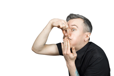 The guy clamped his nose and mouth against a bad smell Stock Photo