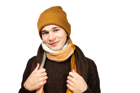 portrait White young guy in sweater, in hat. Isolated on a white background.