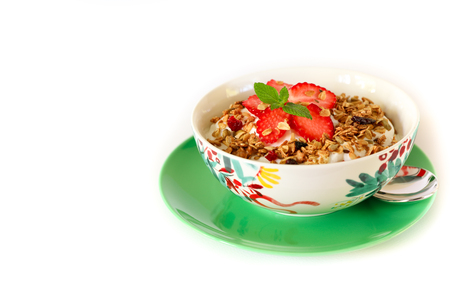 Healthy breakfast granola, strawberry and yogurt isolated on white background.