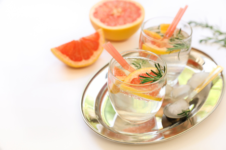 Detox drink with grapefruit, rosemary and ice.