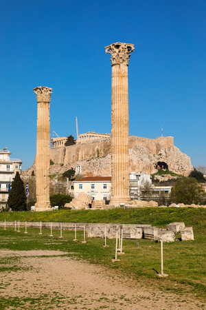 A view to the Acropolis Hill through two columns of the Olympian Zeus Temple, Athens, Greece. Stock Photo