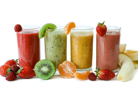 Four different smoothies of berry, banana with tangerine, kiwi, strawberries. Фото со стока