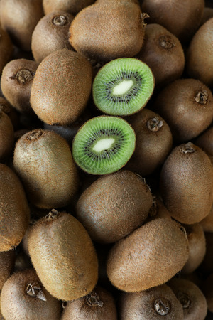 Kiwi fruits on the counter for sale in a vegetable shop.