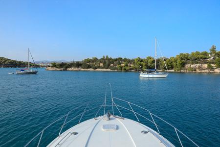 Yachts or pleasure boats anchoring in a bay near Porto Heli, Peloponnese, Greece. Horizontal.