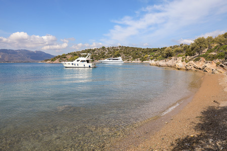 Summer time beautiful yachts anchoring in Love bay Poros island Greece.