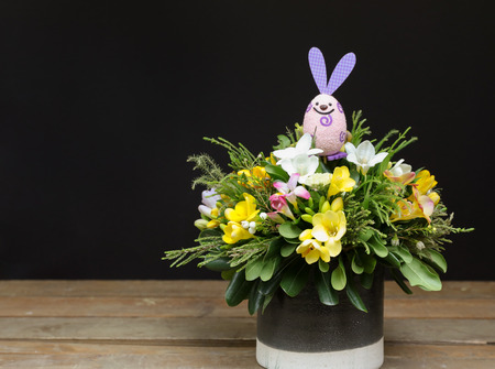 Festive flower arrangement of yellow and white freesia flowers festive flower arrangement of yellow and white freesia flowers and other plants with rabbit easter decorated mightylinksfo