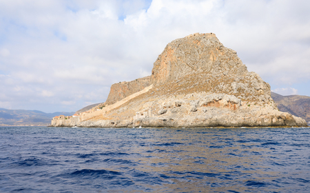 View from the sea to the Monemvasia island medieval castle town, east cost of Peloponnese, Greece, June 2018. Horizontal.