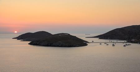 Beautiful sunset of Kolona double bay Kythnos island, Cyclades, Greece.