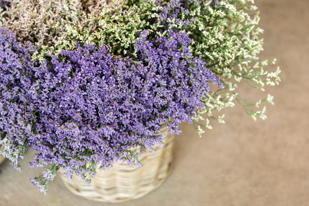 In a wicker basket limonium gmelinii, statice or sea lavender flowers in lavender-blue and white colors in the garden shop.