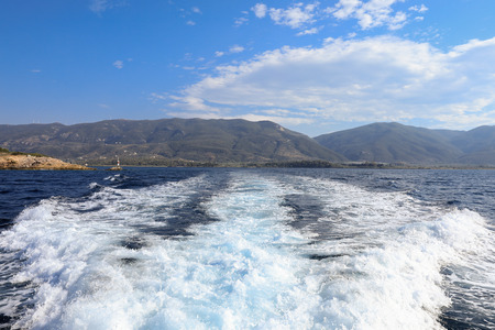 During summer vacation traveling by yacht from the Poros island, Saronic Gulf, Greece.