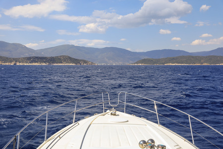 During summer vacation traveling by yacht to the Poros island, Saronic Gulf, Greece. Stok Fotoğraf