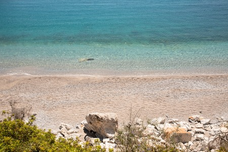 Fantastic turquoise crystal clear water, sand and pebbles of the Agia Kyriaki beach in the Kiparissi Lakonia village