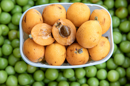 Ripe loquat or Eriobotrya japonica fruits in the greek vegetable fruit shop in May. Stok Fotoğraf