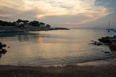 Summertime evening beautiful view from the beach of Aponissos, Agistri island, Saronic gulf, Greece. Horizontal.