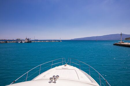 Passing through the Corinth Canal by yacht, Greece 免版税图像