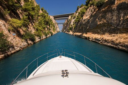 Passing through the Corinth Canal by yacht, Greece.