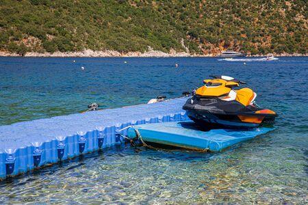Modern jet ski moored on the beautiful Antisamos beach of Kefalonia island, Ionian sea, Greece.