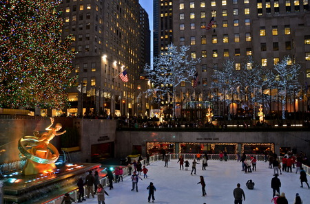 Ice skaters and the famous Rockefeller Center Christmas tree, New York City