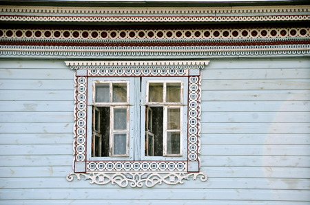 Window of an old russian house decorated with carving, Diveevo, Russia photo